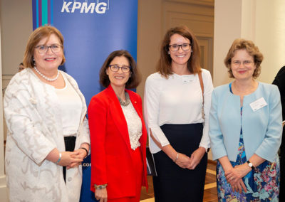 Cath Ingram and Kristy Zwickert from KPMG pose for a photograph with Daryl Karp AM and Frances Adamson